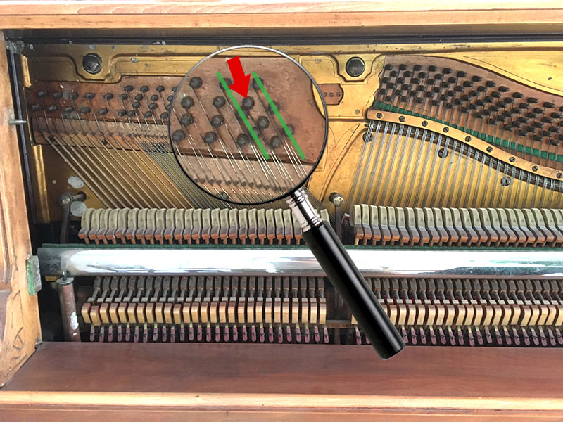Erreur des cordes basses du piano droit Willis